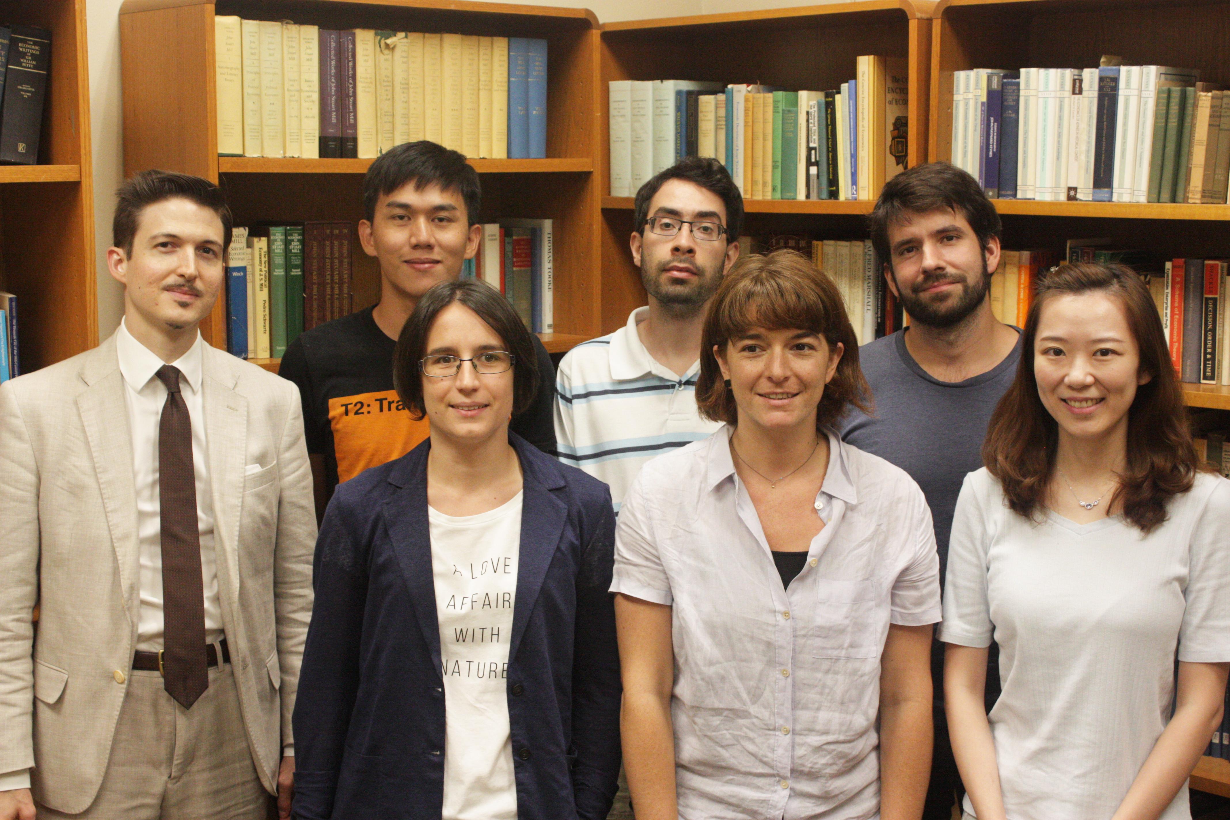 6 Scholars In Front Of A Bookshelf